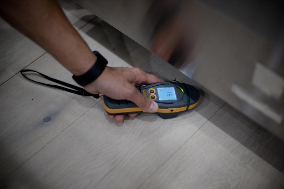 Home inspector checking moisture
