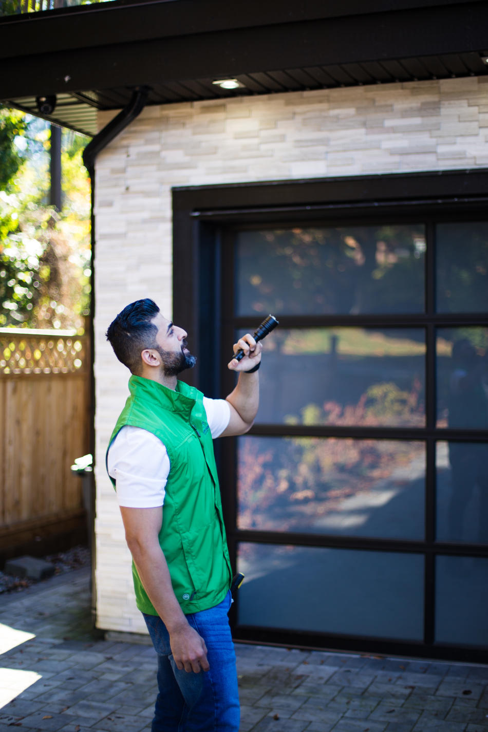 Home inspector checking the exterior of a house