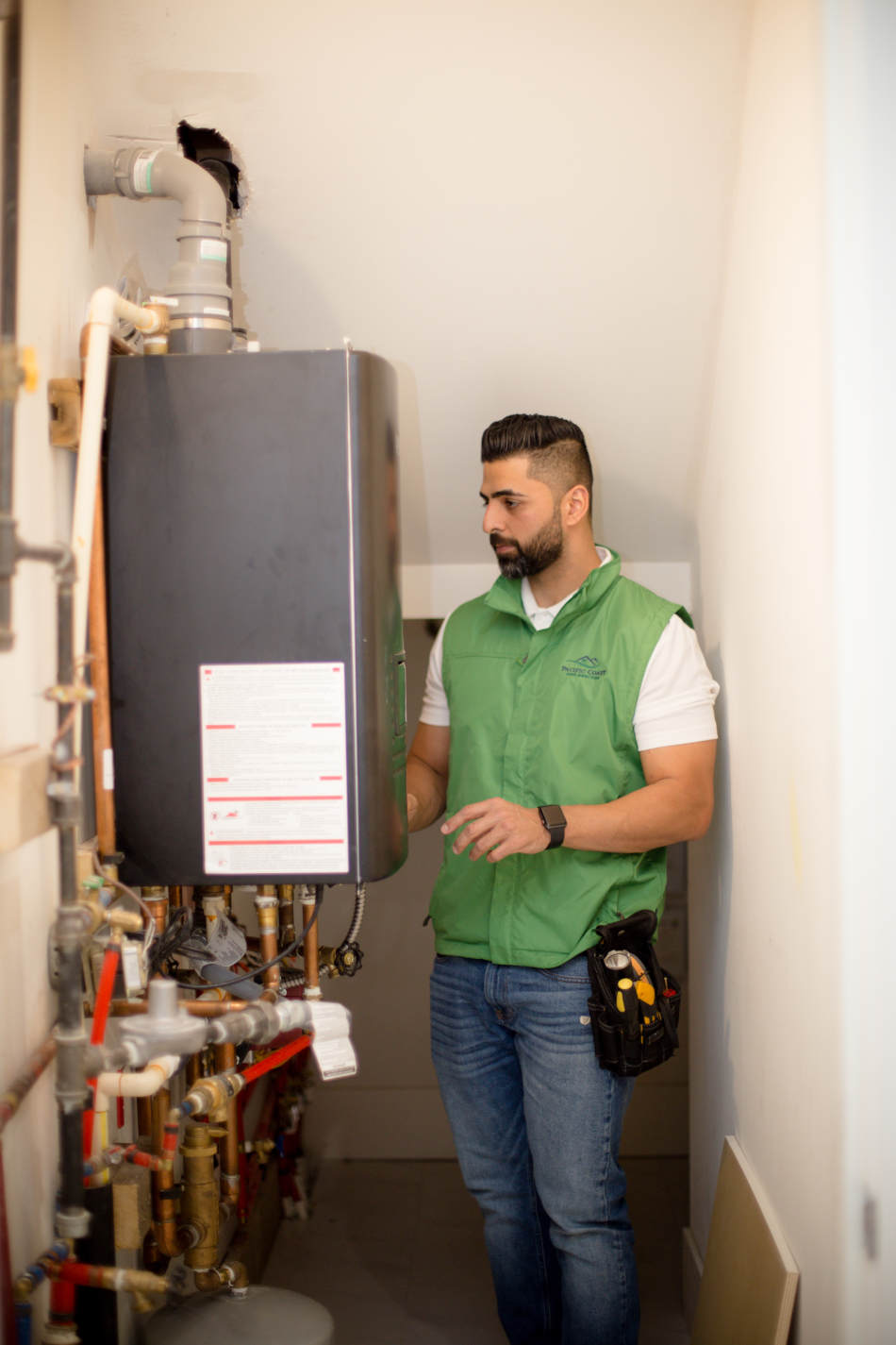 Home inspector checking hot water tank