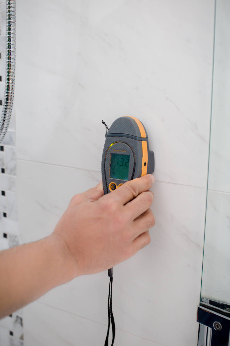 Home inspector measuring moisture